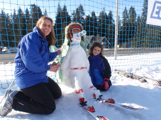 Katie's amazing snowman and her mum!