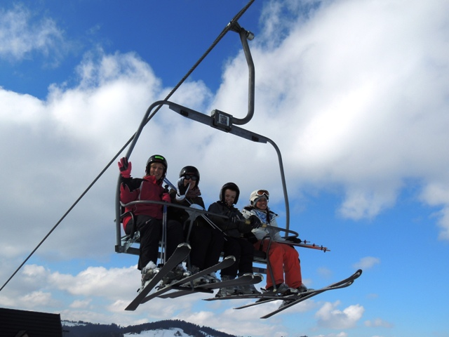 All smiles on the lifts in Zakopane! White Side Holidays Poland showing guests around the slopes
