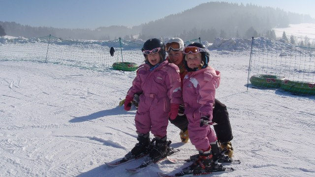 2 of our youngest guests learning to ski with one of our instructors Hanna