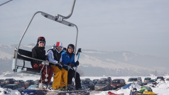 White Side Holidays Poland ski instructor Dawid taking his group up on their ski lesson at Czarna Gora ski area
