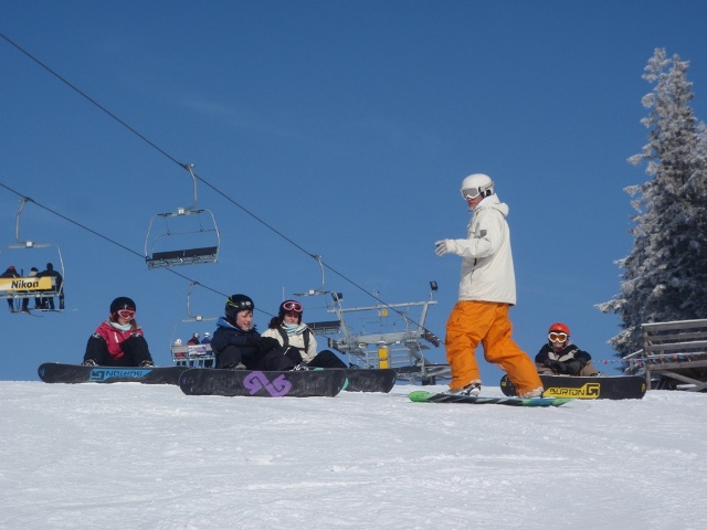 Gaz taking a kids snowboard lesson in Zakopane