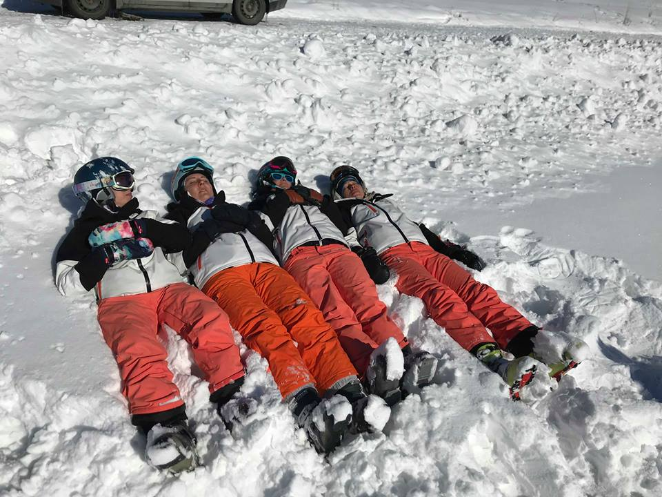 The girl's chilling in the sun in Zakopane, a perfect ski instructors lunch break!
