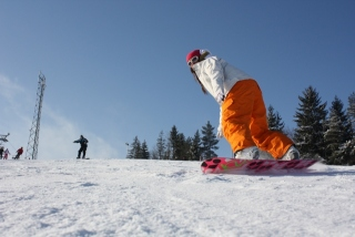Monika snowboarding at Bialka ski area, Poland