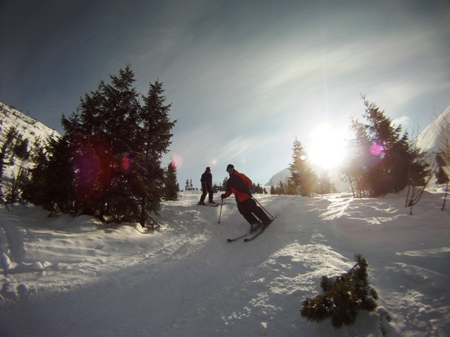 Dan and Tom skiing on Kasprowy Wierch on a bluebird day in Zakopane