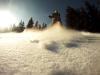 Monika enjoying a powder day whilst snowboarding on a day trip to Jasna, Slovakia in the Tatra Mountains