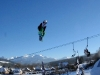Gaz competing in a big air contest, mid rodeo flip in Witow Snow Park