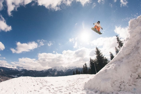 One of our snowboard instructors in Zakopane, Gaz, leaping high above the town