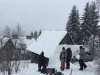 Building a snowboard jump on to an abandoned building roof in Zakopane, Poland with White Side Holidays Poland